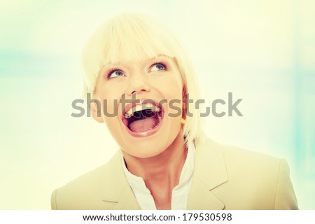 Young business woman shouting,Over abstract blue background  - stock photo