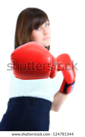 Young Business woman showing boxing glove to the camera