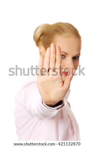 Young business woman shows stop gesture - stock photo