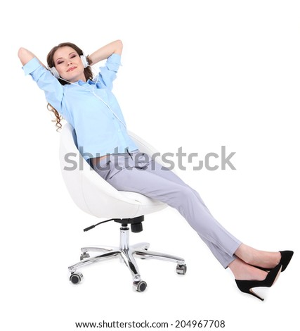 Young business woman sitting on chair with headphones isolated on white