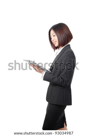 Young Business woman smile using tablet pc isolated on white background, model is a asian beauty - stock photo