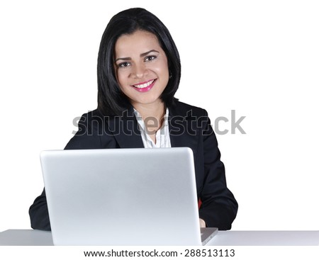 Young business woman smiling and using a computer