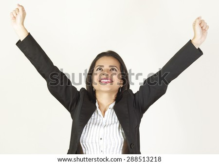 Young business woman smiling looking happy and celebrating