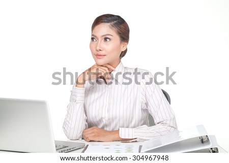 young business woman smiling when working on desk looking up and thinking. isolated on white background