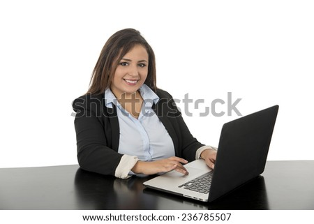 young business woman smiling with laptop against a white background