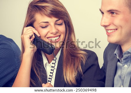Young business woman speaking on the phone - stock photo