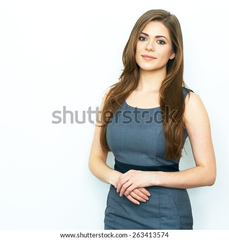 Young Business Woman standing against white background with folded hands. Female model. - stock photo