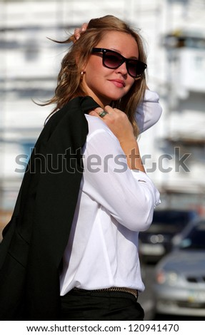 Young business woman standing on the street - stock photo