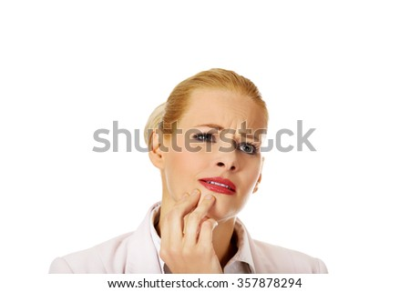 Young business woman suffering from tooth ache. - stock photo
