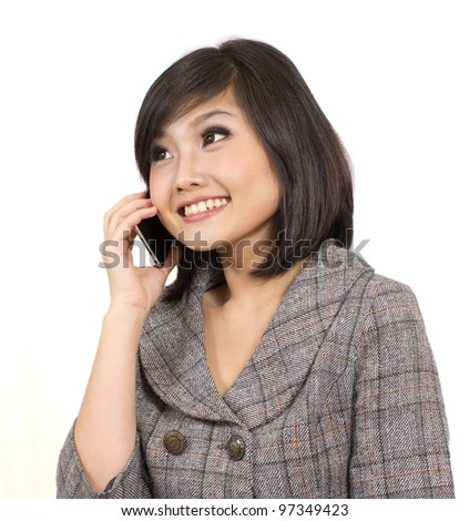 young business woman talking on cell phone - stock photo