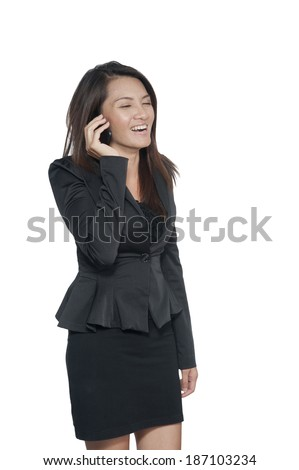 Young business woman talking on cellphone, full length portrait on white background, - stock photo