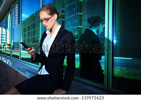 Young business woman talking on her mobile phone in the big city.