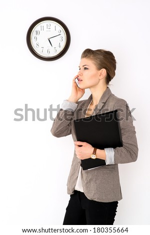Young business woman talking on the phone, isolated on white background.  - stock photo