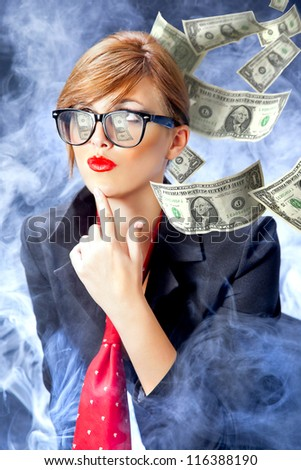 Young business woman thinking about money/Bussines and earning - stock photo