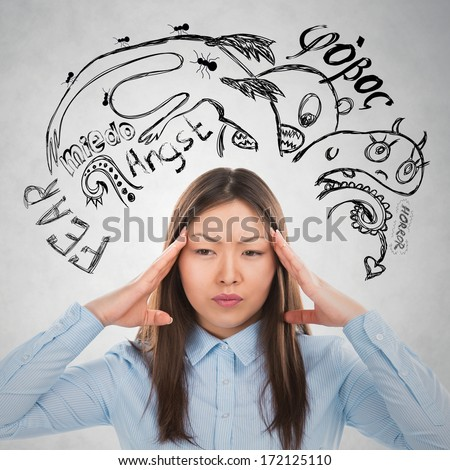 Young business woman thinking of her fears and doubts closeup face portrait and sketches overhead - stock photo
