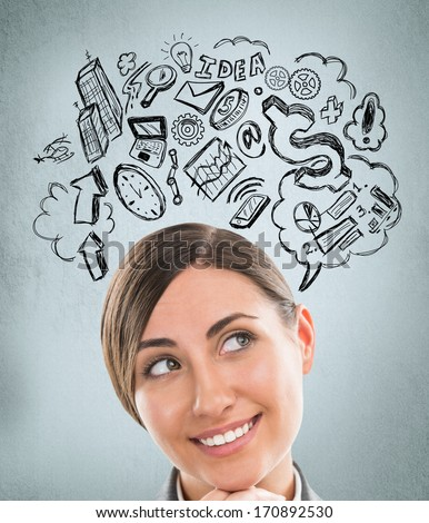 Young business woman thinking of her plans closeup face portrait and sketches overhead - stock photo