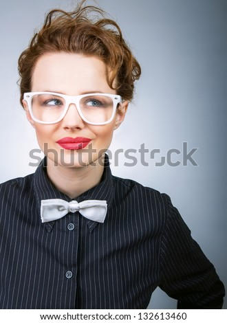 Young business woman thinking, serious stylish girl - stock photo