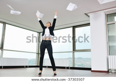 young business woman throw papers and documents from joy in air representing concept of freedom joy and stress control
