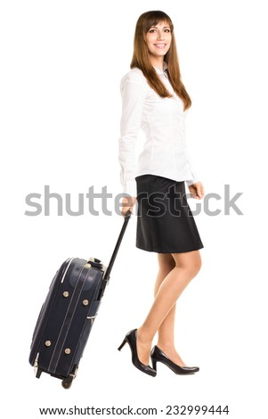 Young business woman traveling with bag isolated on white background - stock photo