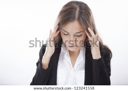 Young business woman trying to concentrate - stock photo