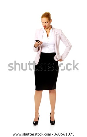 Young business woman using a mobile phone