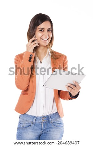 Young business woman using a tablet and a smart-phone at the same time