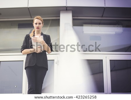 Young business woman using digital tablet in front of her working place - stock photo
