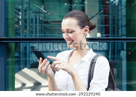 Young business woman using her smart phone.  - stock photo