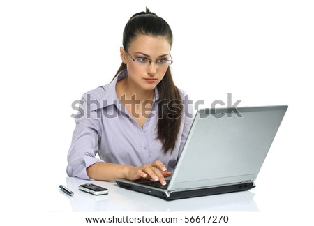 Young business woman using laptop Portrait of a young attractive woman using laptop