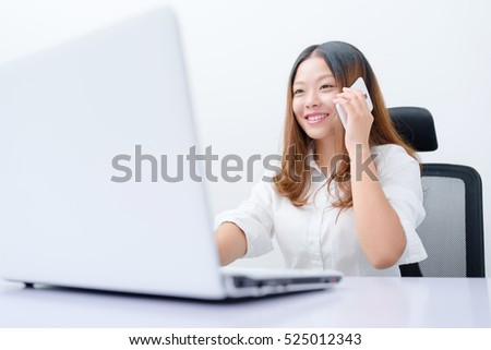 Young business woman using smart phone and laptop work.
