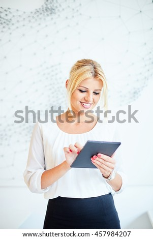 Young business woman using tablet