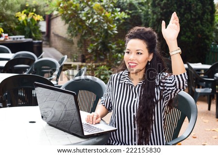 young business woman waving at someone - stock photo