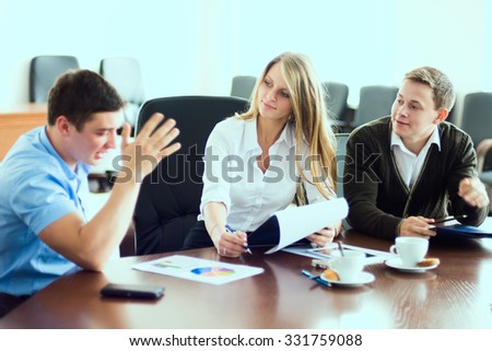 Young business woman with business partners, men at a business meeting. A group of businessmen discussing contract - stock photo