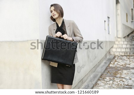 young business woman with business suitcase