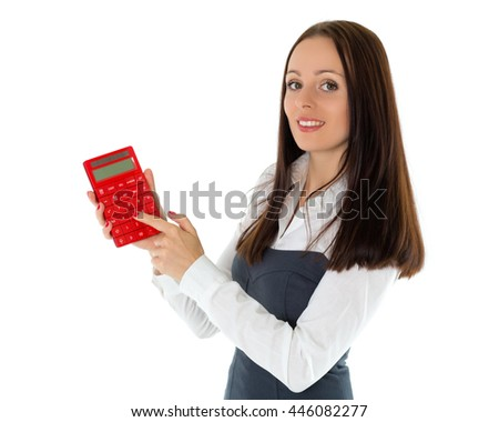 Young business woman with calculator stands on a white background.