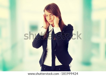 Young business woman with headache - stock photo
