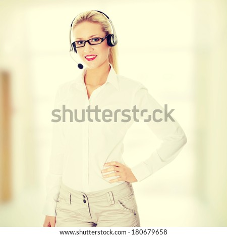 Young business woman with headset - stock photo