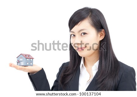 Young business woman with house model, isolated on white background