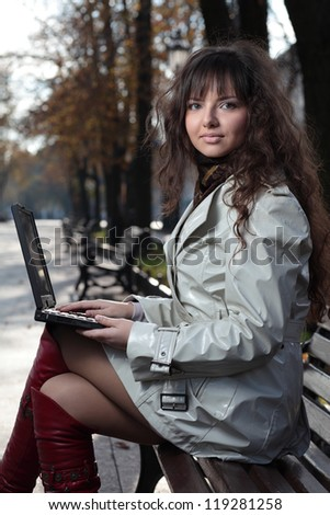 Young business woman with laptop. - stock photo