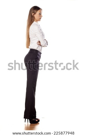 young business woman with long hair posing with crossed arms - stock photo