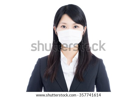 young business woman with mask isolated on white background - stock photo
