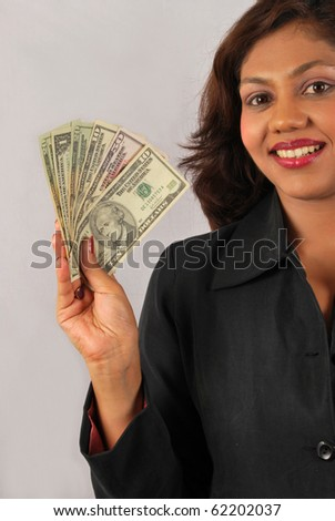 young business woman with money - stock photo