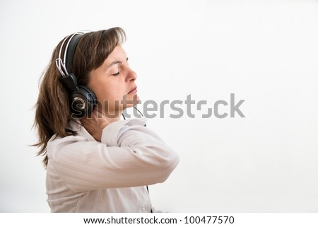 Young business woman with neck pain working at computer