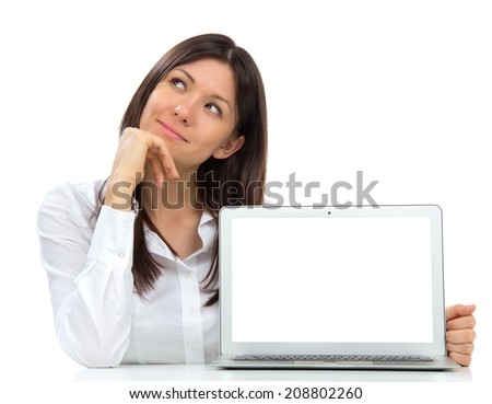 Young business woman with new modern popular laptop keyboard with white screen for text space smiling isolated over white background - stock photo