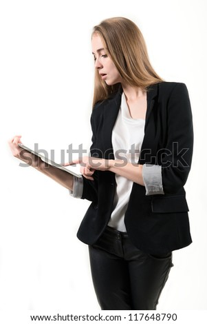 Young business woman with tablet computer. Isolated on white background. - stock photo