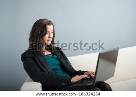 young business woman working on laptop computer
