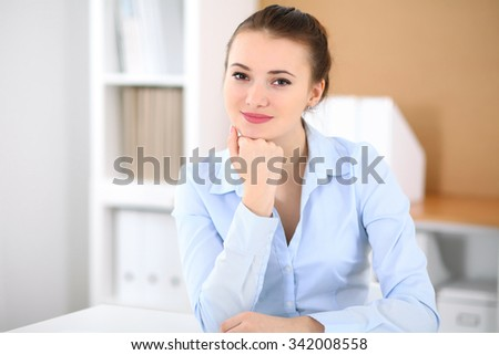 Young business woman working on laptop in office. Successful business concept.   - stock photo