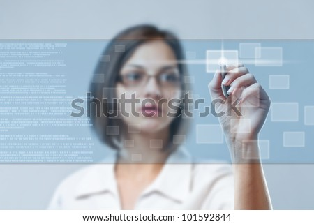Young business woman working on modern technology - stock photo