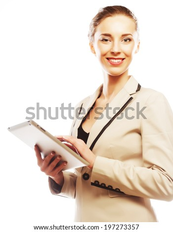 Young business woman working on tablet