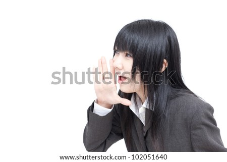 Young business woman working on tablet, isolated on white background - stock photo
